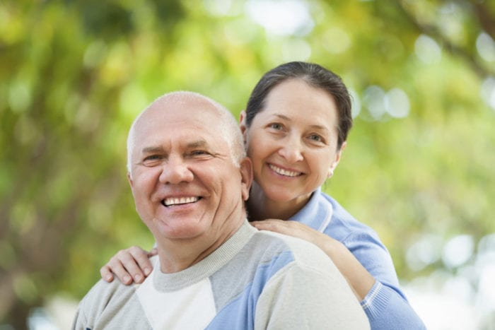 Portrait of mature couple at autumn park woodbridge cosmetic dentist