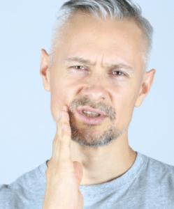 man touching face